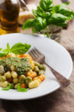 Colored gnocchi with pesto Stock Images