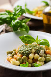 Colored gnocchi with pesto Stock Photo