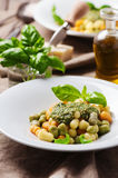 Colored gnocchi with pesto Royalty Free Stock Photography