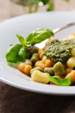 Colored gnocchi with pesto Royalty Free Stock Photos
