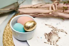 Golden Easter egg and rabbit. Colored and golden Easter eggs and rabbit Royalty Free Stock Photography