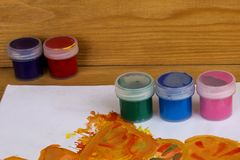 Colored gouache cans on wooden background, Paint for drawing. Kindergarten and school. Multi-colored paint. Children`s creativity. Palette with oil paints and vector illustration