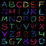 Colored graffiti alphabet and numbers on a black background vector illustration Royalty Free Stock Photo