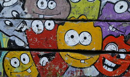 Colored grafitti on old concrete wall. Colored grafitti on concrete wall, 3 pieces of concrete fence royalty free stock photo