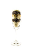 Colored grain in a glass of champagne isolated Stock Photography