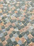 Colored granite paving stone sidewalk Royalty Free Stock Photos