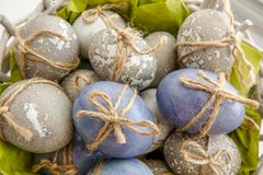 Colored grey and blue decorated Easter Eggs royalty free stock photography