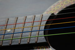 Colored Guitar Strings. A close up picture of colored guitar strings royalty free stock image