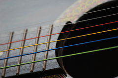 Colored Guitar Strings. A close up picture of colored guitar strings stock image