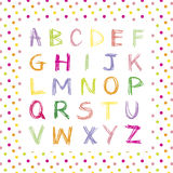 Colored hand drawn alphabet on polka dot background. Colored hand drawn alphabet on colored little polka dot background. Child alphabet Stock Photo