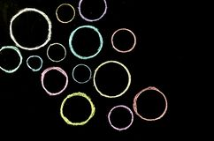 Colored hand drawn circles on chalkboard.  royalty free stock images