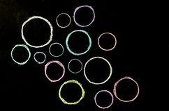 Colored hand drawn circles on chalkboard.  stock photography