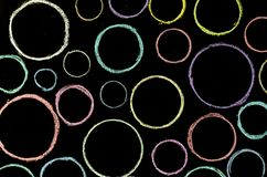 Colored hand drawn circles on chalkboard.  stock photos