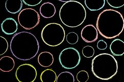 Colored hand drawn circles on chalkboard.  stock photo