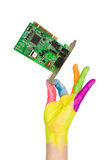 Colored hand holding computer card Royalty Free Stock Images