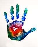 Colored hand love. A hand print with a mixed colors Royalty Free Stock Photography