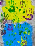 Colored hand prints on wall. Beautiful colored hand prints on wall royalty free stock photography