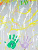 Colored hand prints on wall. Beautiful colored hand prints on wall royalty free stock photo