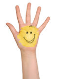 Colored hand with smile. Colored hand with a smile Royalty Free Stock Images