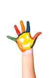 Colored hand with smile painted in colorful paints as logo. Royalty Free Stock Photos