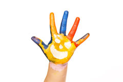 Colored hand with smile painted in colorful paints as logo. Isolated on white background stock photos