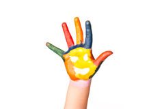 Colored hand with smile painted in colorful paints as logo. Royalty Free Stock Images