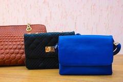 Colored handbags closeup. Women's accessories. Stock Photos