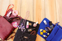 Colored handbags, cosmetics, women's accessories Royalty Free Stock Image