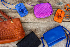 Colored handbags on wooden background. Top view Royalty Free Stock Images