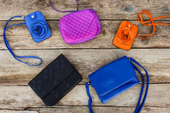 Colored handbags. On wooden background. Top view Royalty Free Stock Images