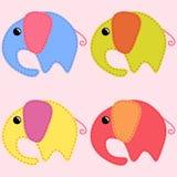Colored handmade elephants. Cute colored handmade elephants over light pink background Stock Photo
