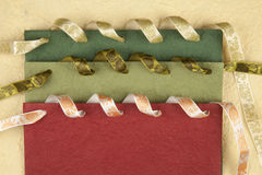 Colored handmade paper. With ribbons Stock Photography