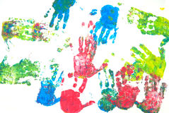 Colored hands print. Brightly coloured hands print on white background Stock Photos