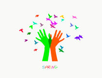 Colored hands, producing colorful birds. Colored vector illustration depicting hands, letting out a flock of birds Stock Images
