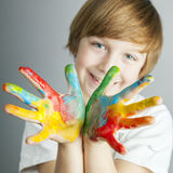 Colored hands. Smiling child showing his colored hands royalty free stock photos