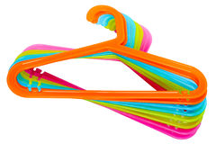 Colored hangers. Colored plastic hangers isolated on white background Royalty Free Stock Photos