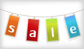 Colored hanging sale labels. Royalty Free Stock Image