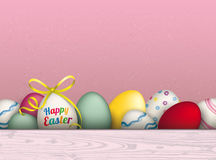 Colored Happy Easter Eggs Pink Background. Colored eggs with ribbon and text Happy Easter stock illustration