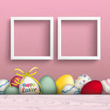 Colored Happy Easter Eggs Pink 2 Frames. Colored eggs with ribbon and 2 white frames Stock Images