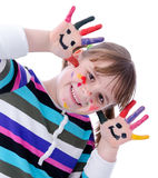 Colored happy girl. Adorable child girl have paint with painting Stock Image