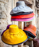 Colored hats Stock Images