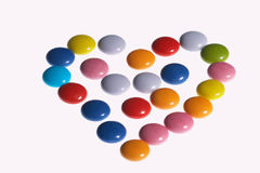 Colored heart - faerbiges Herz. Heart shaped out of colored sweets - aus faerbigen Bonbons geformtes Herz Royalty Free Stock Photos
