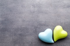 Colored heart on the gray background. View from above. Flat lay. royalty free stock photo