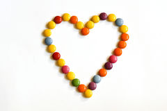 Colored heart. Heart is made of colored candy Stock Images