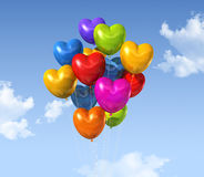 Colored heart shape balloons on a blue sky Stock Photography
