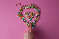 Colored heart from sweet dragees Stock Photo