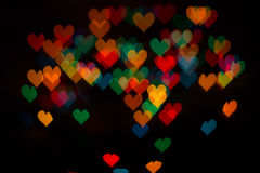 Colored hearts. Background of colored hearts shaped bokeh Royalty Free Stock Images