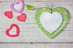 Colored hearts over wooden background - Valentine\'s day concept.  royalty free stock image