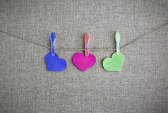 Colored hearts on a string on a background of burlap_ Stock Image