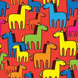 Colored horses seamless pattern on red Stock Image